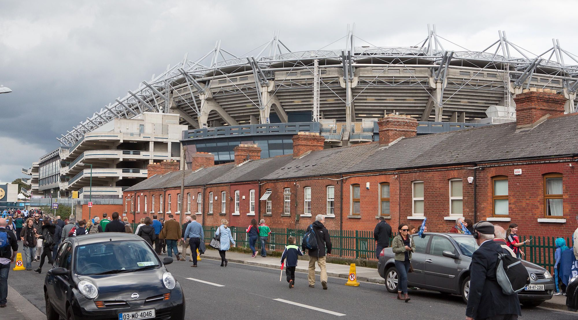 Supporters arrive outside Croke Park for the GAA All-Ireland Gaelic Football Final replay match between Dublin and Mayo at Croke Park, Dublin, Ireland, on October 1, 2016. Photo: Karl Burke/AFP. The biggest crowd in Europe on Saturday will not be watching detached professionals kissing the badge of their latest football team, but at the All-Ireland Gaelic football final. Two amateur teams, Dublin and Mayo, will attempt to win the coveted All-Ireland trophy for Gaelic football in a replay following a rare draw two weeks ago. / AFP / Karl Burke (Photo credit should read KARL BURKE/AFP via Getty Images)