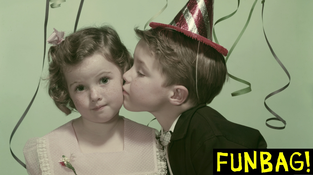 little boy and little boy kissing at party