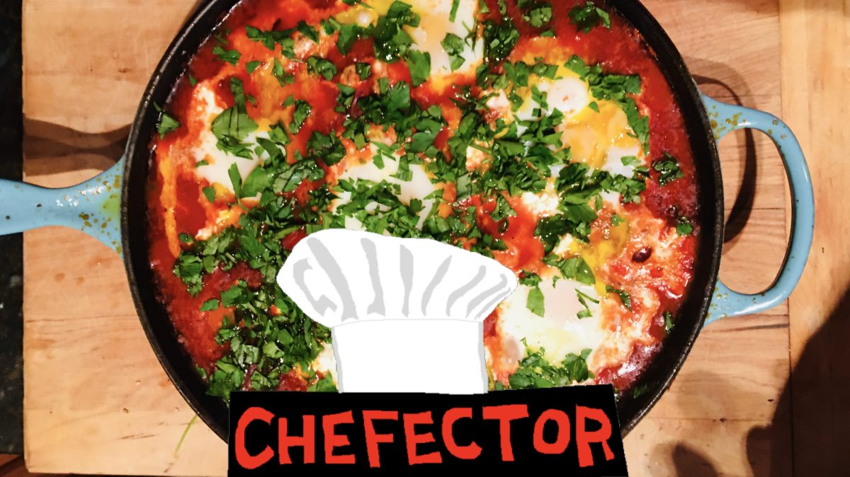 A pan of shakshouka, eggs poached in tomatoes and peppers