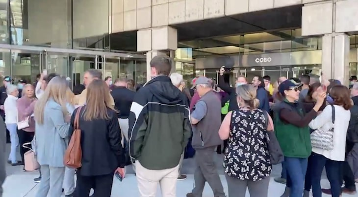 """A crowd of dorks chants """"stop the vote"""" in front of an election station in Detroit."""