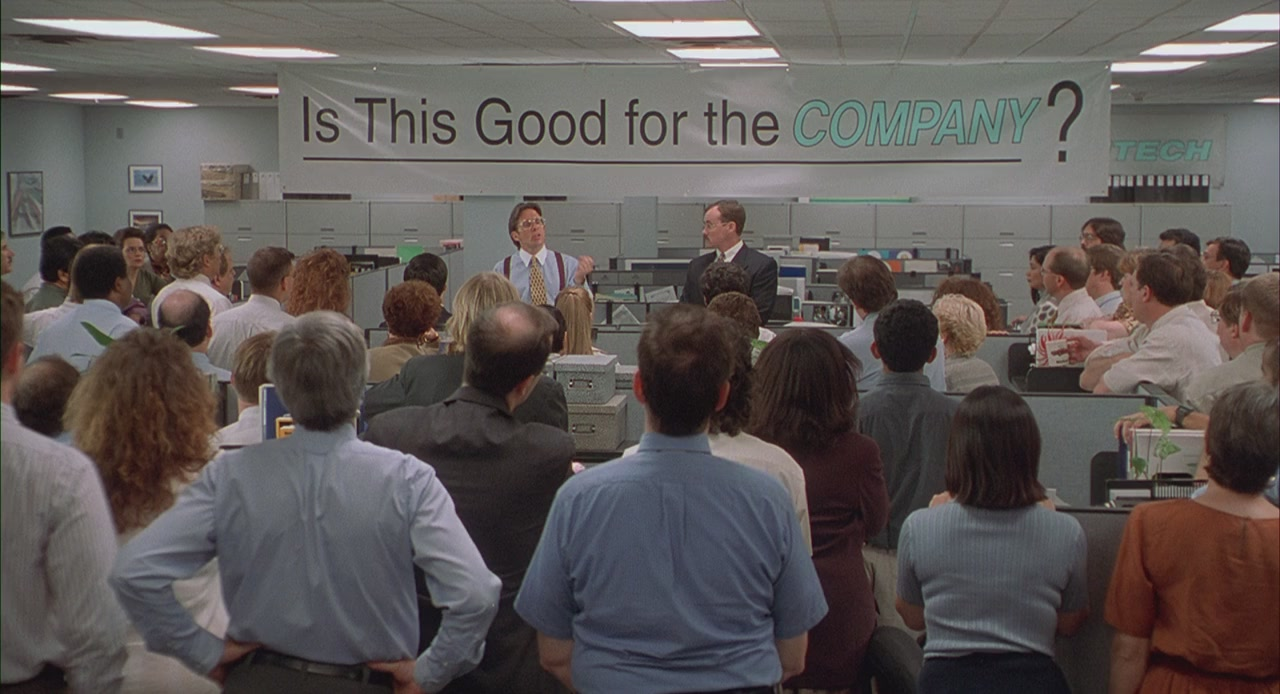 A scene of a meeting from Office Space, a Mike Judge film.