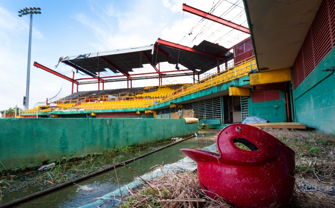 CAROLINA, PUERTO RICO - NOVEMBER 13: A remaining batting helmet sits on the field at the Roberto Clemente Municipal Stadium on November 13, 2018 in Carolina, Puerto Rico. The ballpark was once used for minor league AA baseball. The stadium is set to be demolished due to the extended damage it sustained from Hurricane Maria. The effort continues in Puerto Rico to remain and rebuild more than one year after the Hurricane Maria hit and devastated the island on September 20, 2017. The official number of deaths from the disaster is 2,975. (Photo by Al Bello/Getty Images for Lumix)