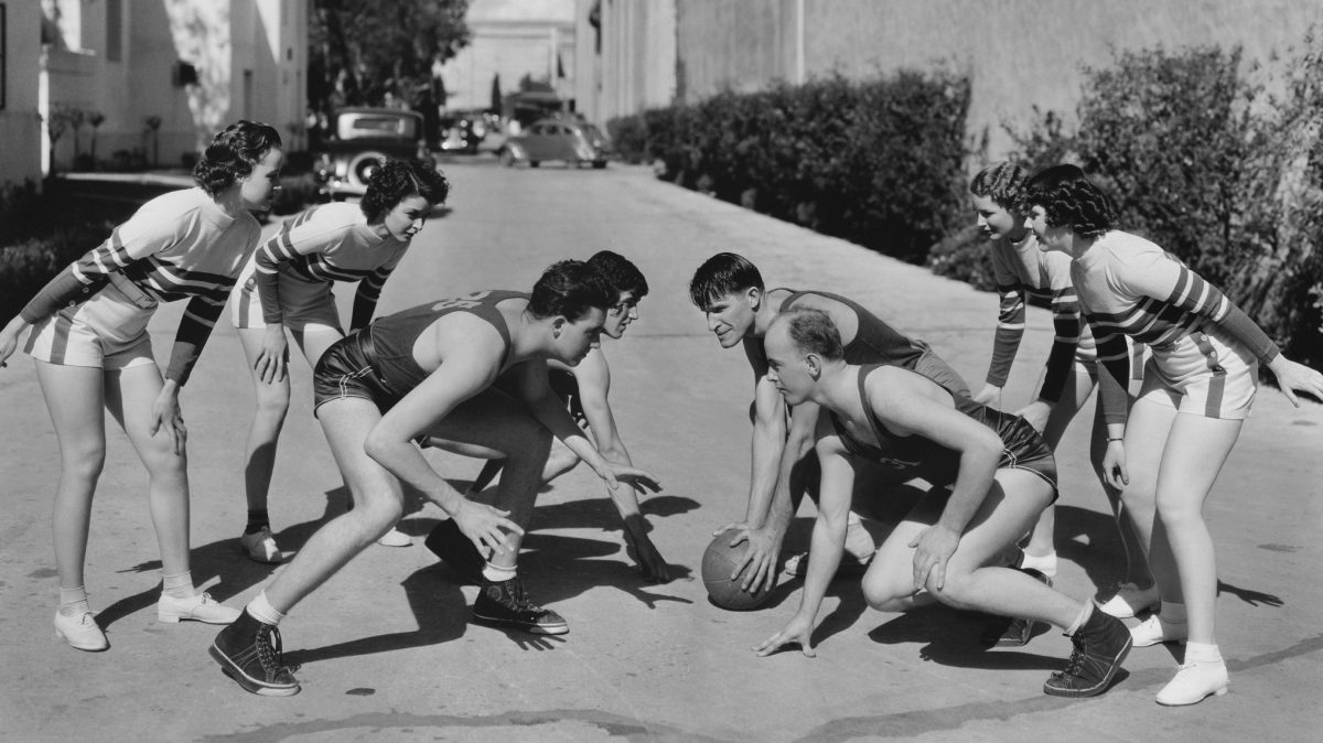 Old-time basketball players, in what appears to be an alley in Los Angeles maybe