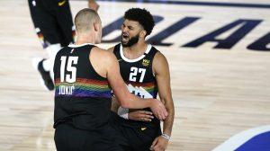 Nikola Jokic and Jamal Murray of the Denver Nuggets celebrate