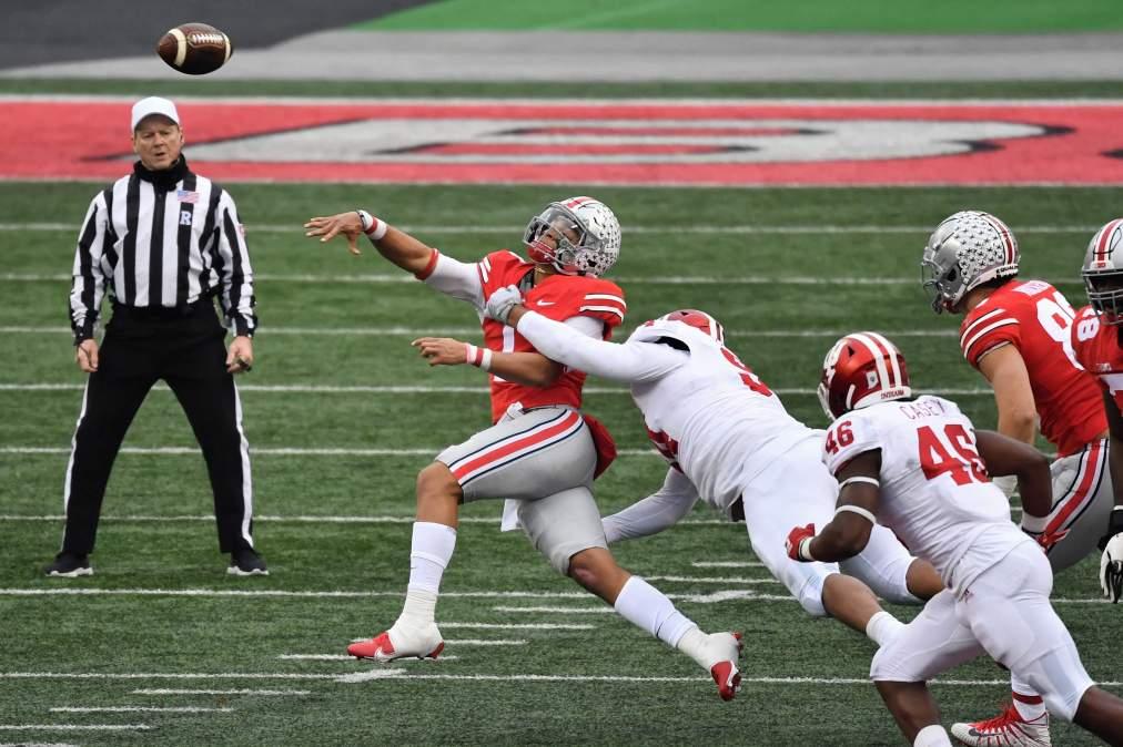Demarcus Elliott #94 of the Indiana Hoosiers applies pressure to quarterback Justin Fields #1 of the Ohio State Buckeyes