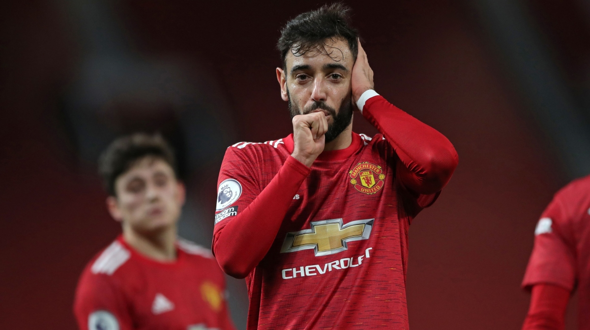 Manchester United's Portuguese midfielder Bruno Fernandes celebrates after scoring their third goal during the English Premier League football match between Manchester United and Leeds United at Old Trafford in Manchester, north west England, on December 20, 2020.