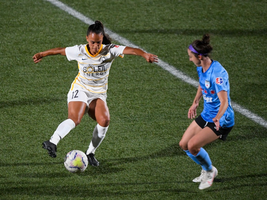 two nwsl players fight for a ball