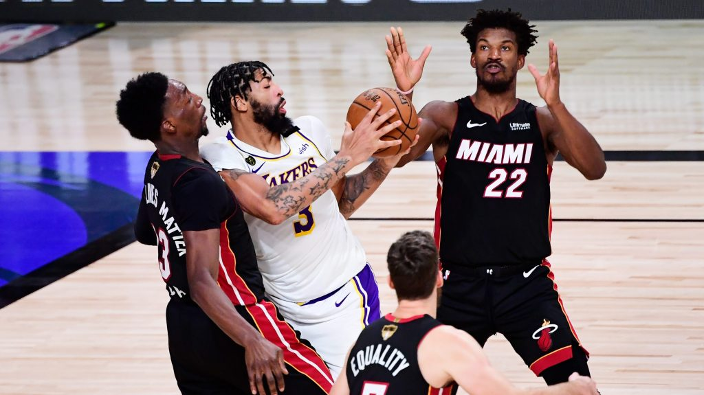 Various Miami Heat players surround Anthony Davis of the Los Angeles Lakers during the 2020 NBA Finals