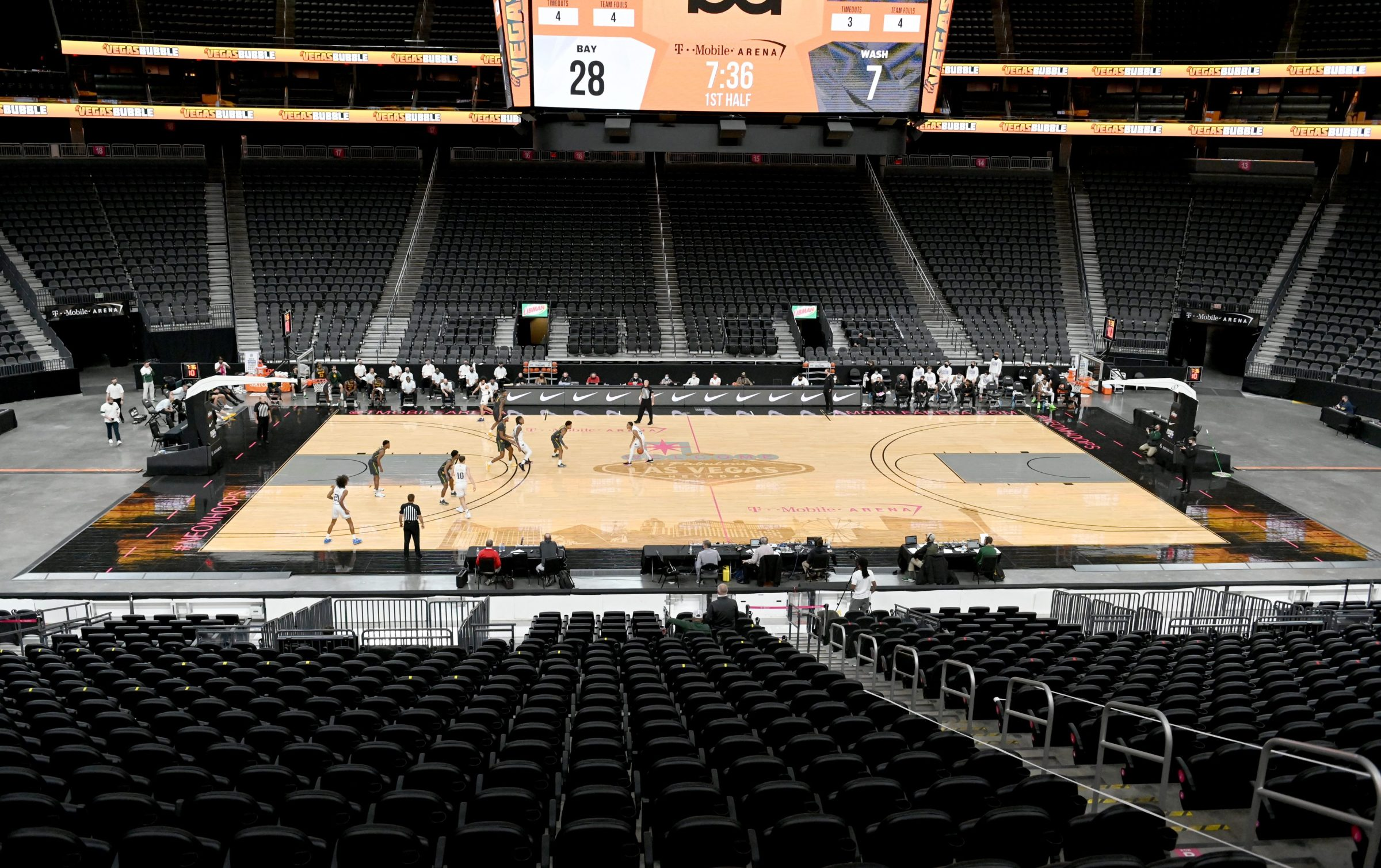 The Washington Huskies and the Baylor Bears play in the first half of their game during the #VegasBubble basketball tournament in an empty T-Mobile Arena