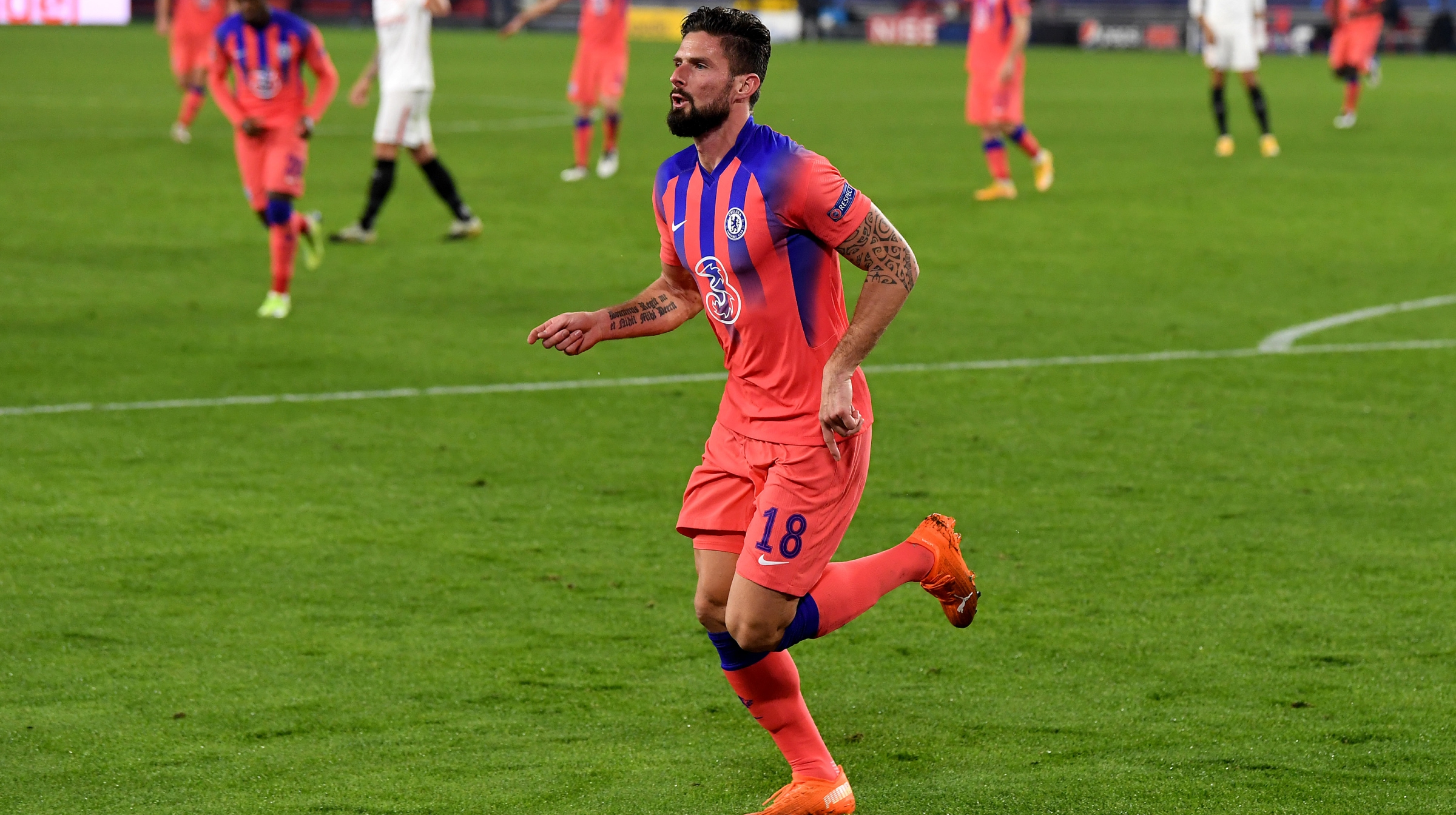 Olivier Giroud of Chelsea celebrates after scoring their sides second goal during the UEFA Champions League Group E stage match between FC Sevilla and Chelsea FC at Estadio Ramon Sanchez Pizjuan on December 02, 2020 in Seville, Spain.