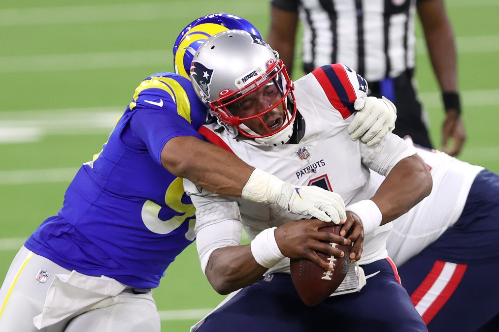 Cam Newton #1 of the New England Patriots is sacked by Aaron Donald #99 of the Los Angeles Rams