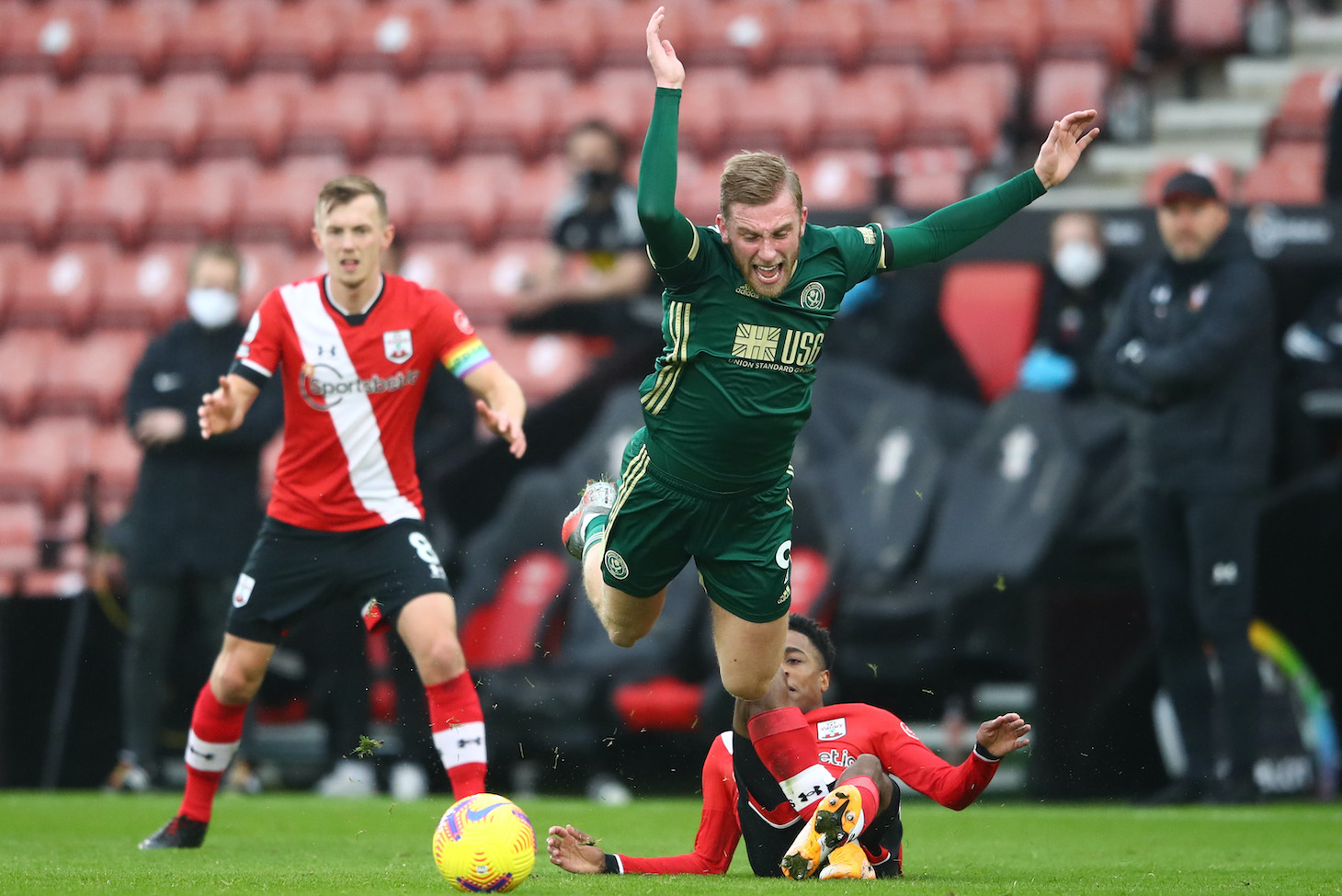 Oliver McBurnie of Sheffield United is fouled by Kyle Walker-Peters of Southampton during the Premier League match between Southampton and Sheffield United at St Mary's Stadium on December 13, 2020 in Southampton, England. A limited number of spectators (2000) are welcomed back to stadiums to watch elite football across England. This was following easing of restrictions on spectators in tiers one and two areas only.