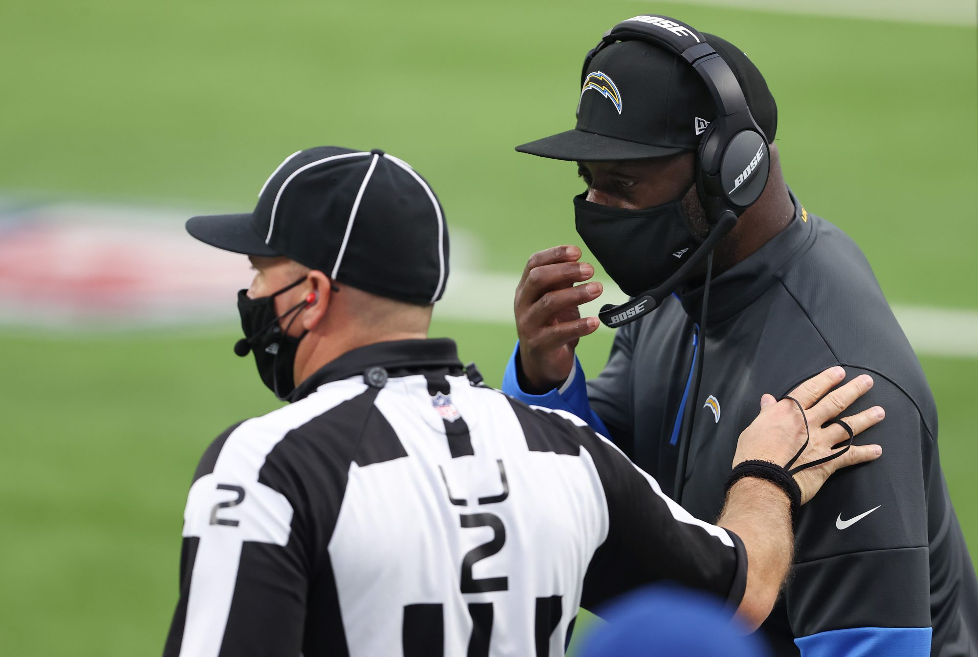 Chargers head coach Anthony Lynn talks with an official.