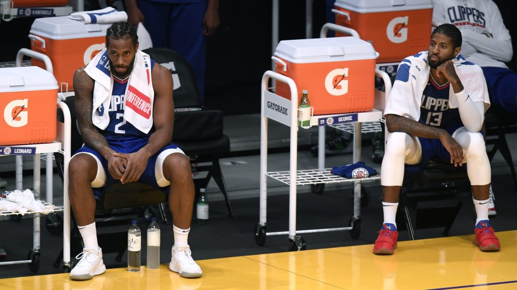 Kawhi Leonard and Paul George of the Los Angeles Clippers sit hilariously far apart on the sideline