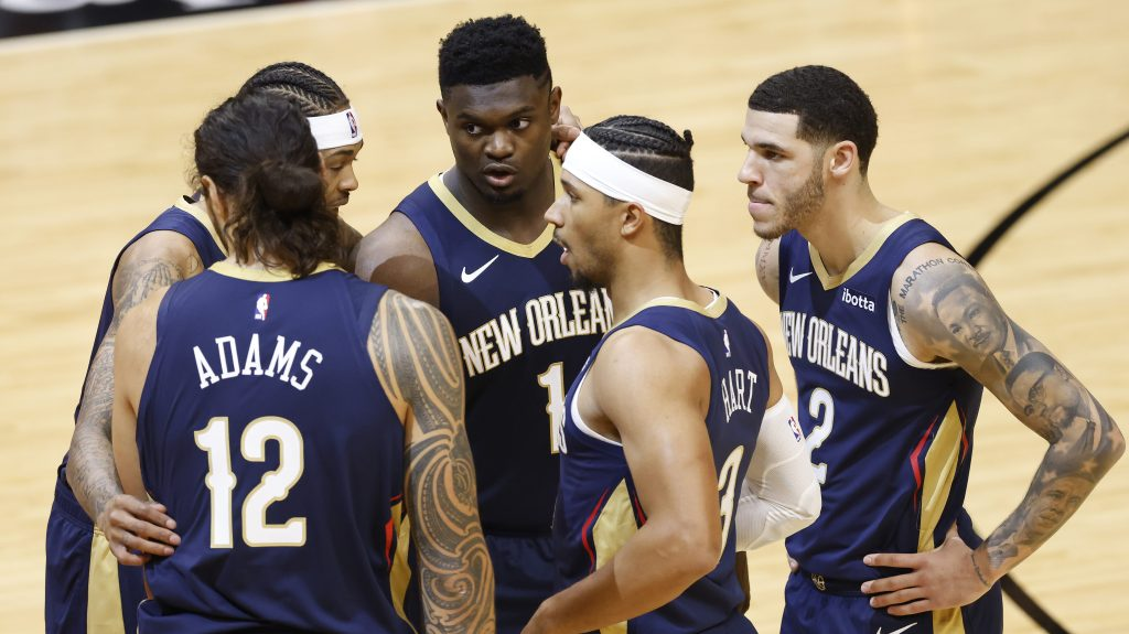 Zion Williamson and New Orleans Pelicans teammates huddle on the court