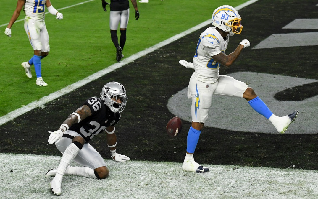 LAS VEGAS, NEVADA - DECEMBER 17: Wide receiver Tyron Johnson #83 of the Los Angeles Chargers celebrates after scoring a 26-yard touchdown against Daryl Worley #36 of the Las Vegas Raiders during the first half of their game at Allegiant Stadium on December 17, 2020 in Las Vegas, Nevada. The Chargers defeated the Raiders 30-27 in overtime. (Photo by Ethan Miller/Getty Images)