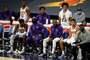 Some Phoenix Suns players sit on the bench