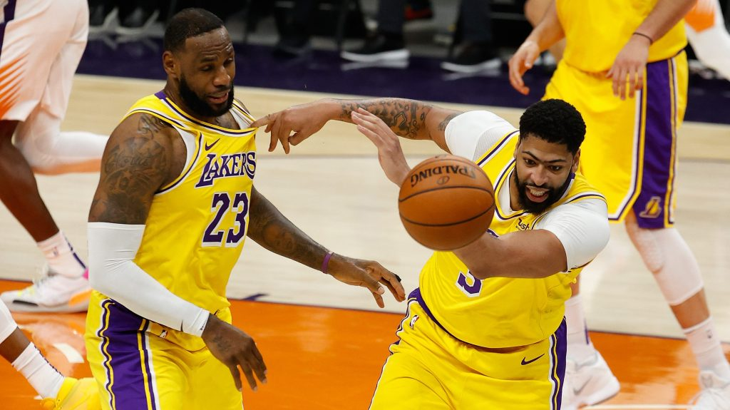 LeBron James and Anthony Davis of the Los Angeles Lakers pursue a loose ball