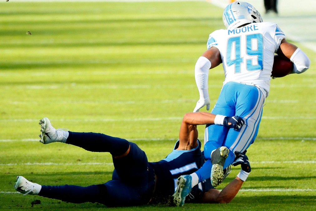 NASHVILLE, TENNESSEE - DECEMBER 20: C.J. Moore #49 of the Detroit Lions is tackled short of a first down by Nick Westbrook #15 of the Tennessee Titans for a turnover on downs on a fake punt during the fourth quarter of the game at Nissan Stadium on December 20, 2020 in Nashville, Tennessee. (Photo by Frederick Breedon/Getty Images)
