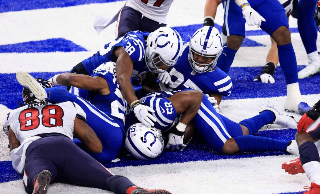 INDIANAPOLIS, INDIANA - DECEMBER 20: Bobby Okereke #58 of the Indianapolis Colts recovers a fumble in the end zone in the game against the Houston Texans during the fourth quarter at Lucas Oil Stadium on December 20, 2020 in Indianapolis, Indiana. (Photo by Justin Casterline/Getty Images)