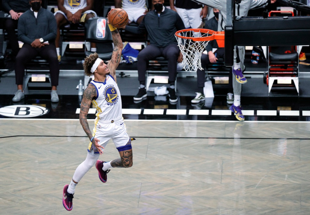 NEW YORK, NEW YORK - DECEMBER 22: Kelly Oubre Jr. #12 of the Golden State Warriors dunks during the first half against the Brooklyn Nets at Barclays Center on December 22, 2020 in the Brooklyn borough of New York City. NOTE TO USER: User expressly acknowledges and agrees that, by downloading and/or using this photograph, user is consenting to the terms and conditions of the Getty Images License Agreement. (Photo by Sarah Stier/Getty Images)