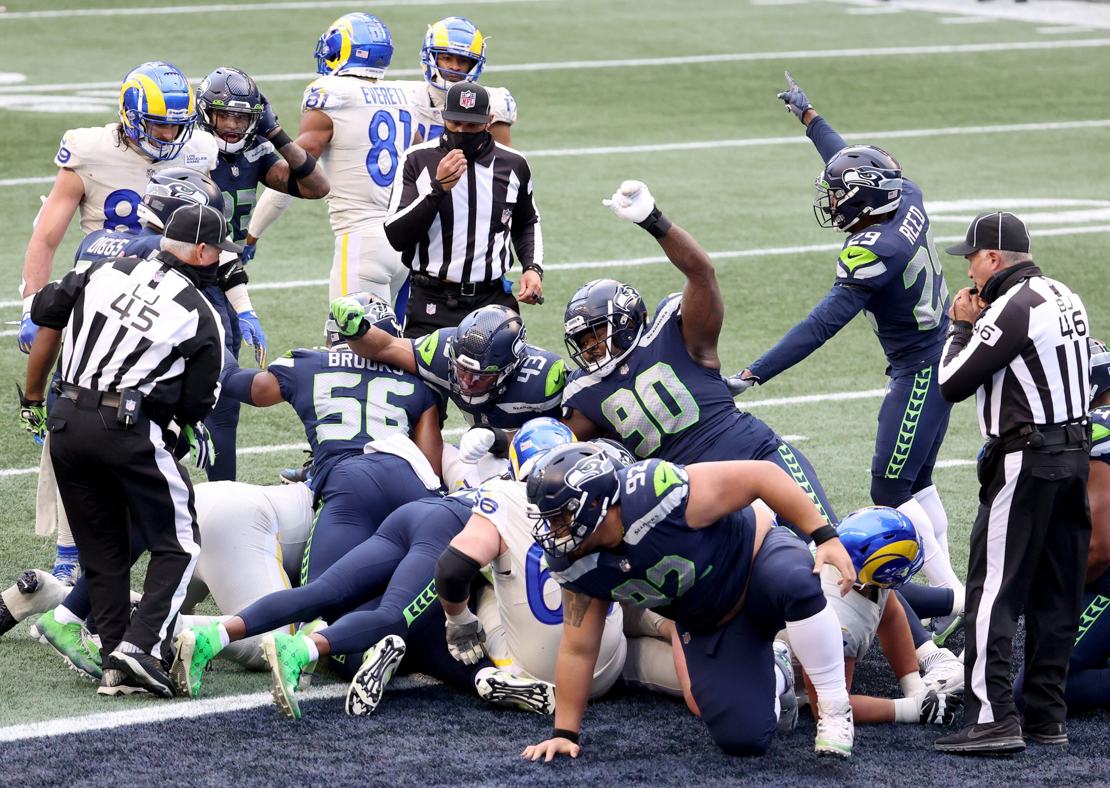 The Seattle Seahawks defense celebrates a stop on third down