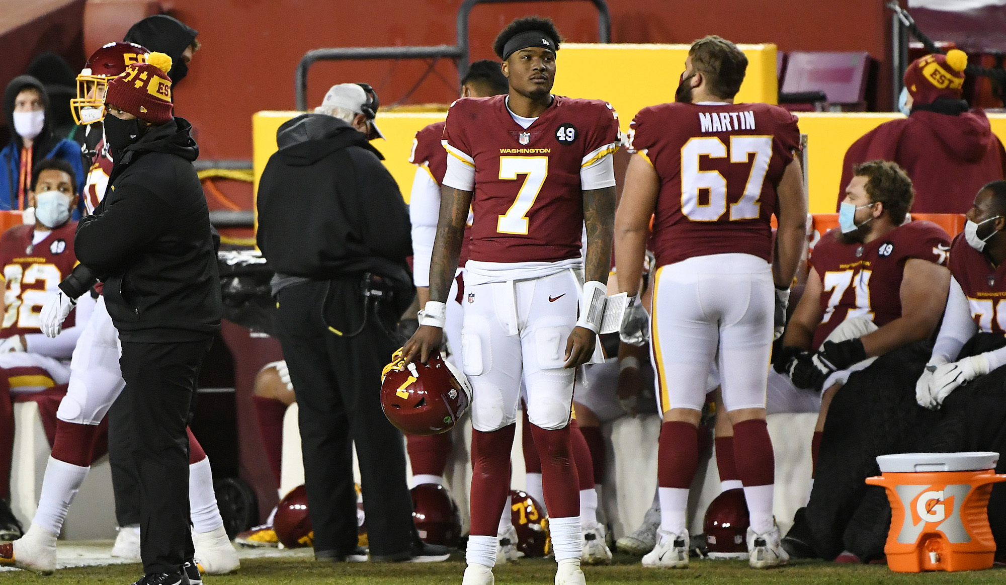 LANDOVER, MARYLAND - DECEMBER 27: Dwayne Haskins #7 of the Washington Football Team reacts on the sideline against the Carolina Panthers during the fourth quarter at FedExField on December 27, 2020 in Landover, Maryland. (Photo by Will Newton/Getty Images)