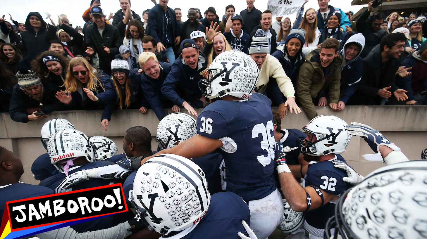 NEW HAVEN, CT - NOVEMBER 18: Deonte Henson #21 of the Yale Bulldogs is congratulated by teammates after making an interception in teh fourth quarter of a game against the Harvard Crimson at the Yale Bowl on November 18, 2017 in New Haven, Connecticut. (Photo by Adam Glanzman/Getty Images)