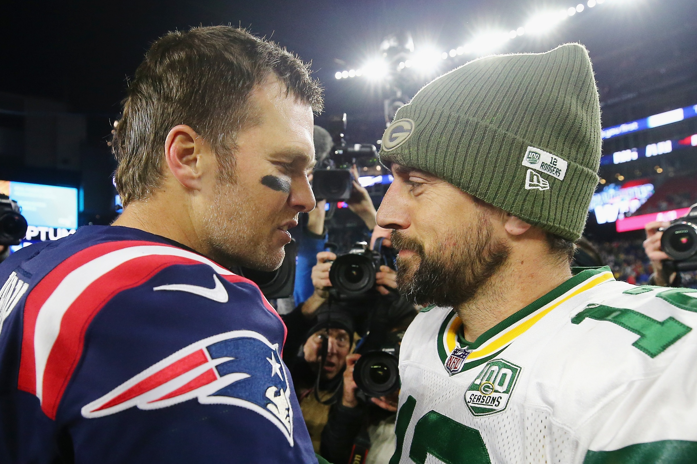 Tom Brady #12 of the New England Patriots talks with Aaron Rodgers #12 of the Green Bay Packers