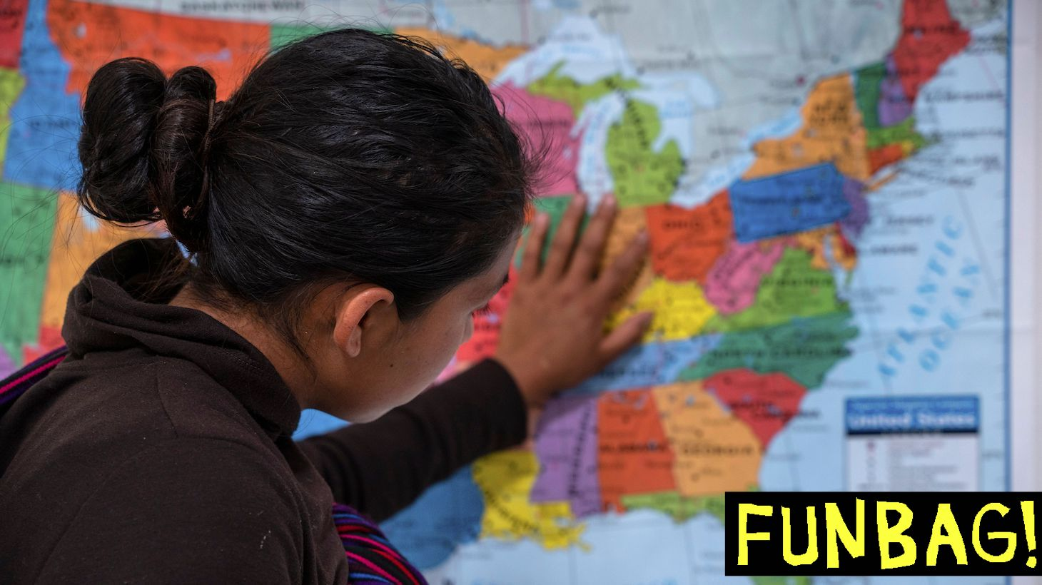 """A Guatemalan woman touches a map of the United States at the Casa del Refugiado, or The House of Refugee, a new centre opened by the Annunciation House to help the large flow of migrants being released by the United States Border Patrol and Immigration and Customs Enforcement in El Paso, Texas on April 24, 2019. - The 125,000 foot space will accomodate about 500 migrants, with plans to expand for up to 1,500. While this is larger then other centres in the El Paso area, Father Ruben Garcia the director of Annunciation house says that they will still rely on churches around the community for help housing migrants. According to the CBP, border patrol agents apprehended 92,607 people along the southwest border in March, up from 66,884 in February. US President Donald Trump, who has made immigration the core of his message to his conservative base, said on Twitter that """"a very big Caravan of over 20,000 people"""" is making its way through Mexico toward the United States. (Photo by Paul Ratje / AFP) (Photo credit should read PAUL RATJE/AFP via Getty Images)"""