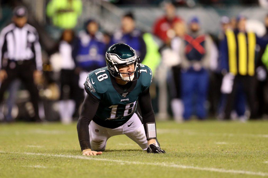 Quarterback Josh McCown #18 of the Philadelphia Eagles stumbles to the ground