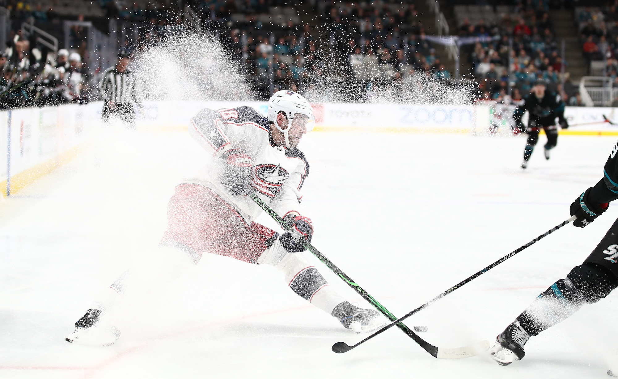 SAN JOSE, CALIFORNIA - JANUARY 09: Pierre-Luc Dubois #18 of the Columbus Blue Jackets stops on the ice during their game against the San Jose Sharks at SAP Center on January 09, 2020 in San Jose, California. (Photo by Ezra Shaw/Getty Images)
