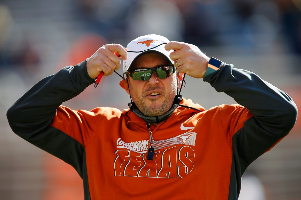 Tom Herman of the Texas Longhorns prepares for a game