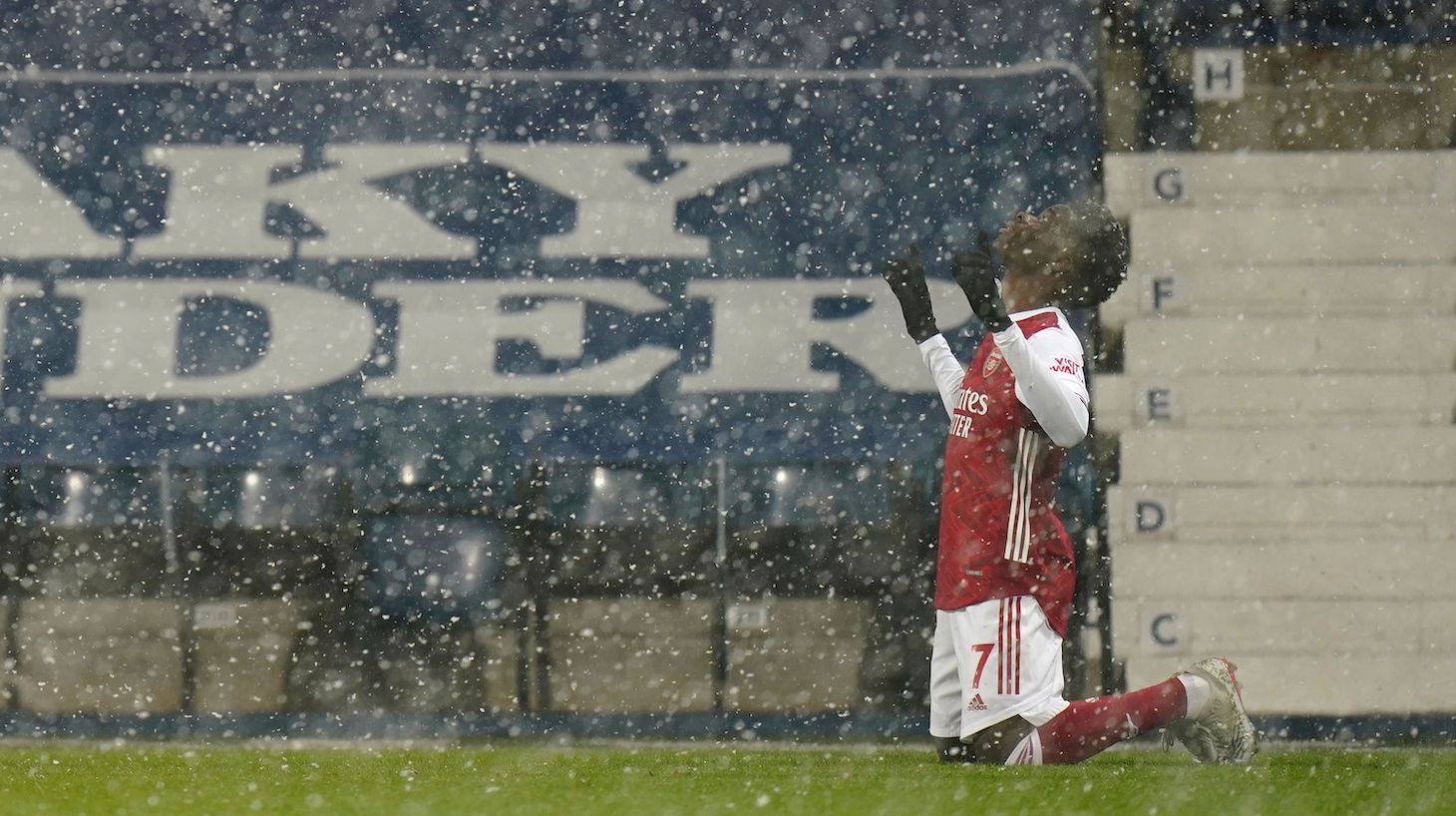 Arsenal's English striker Bukayo Saka celebrates scoring their second goal during the English Premier League football match between West Bromwich Albion and Arsenal at The Hawthorns stadium in West Bromwich, central England, on January 2, 2021.