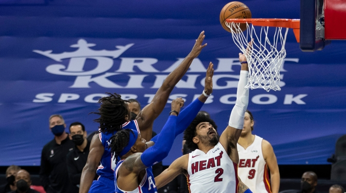 Gabe Vincent #2 of the Miami Heat shoots the ball against Tyrese Maxey #0 and Dwight Howard #39 of the Philadelphia 76ers in the second quarter during their game at the Wells Fargo Center on January 12, 2021 in Philadelphia, Pennsylvania.