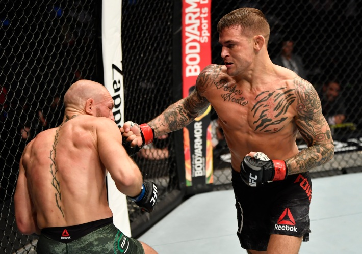 Dustin Poirier punches Conor McGregor