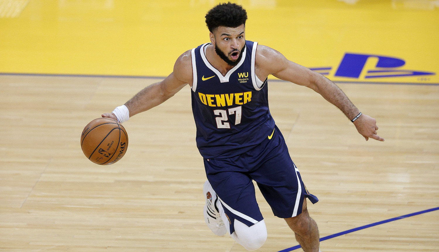 SAN FRANCISCO, CALIFORNIA - DECEMBER 12: Jamal Murray #27 of the Denver Nuggets in action against the Golden State Warriors during their NBA preseason game at Chase Center on December 12, 2020 in San Francisco, California. NOTE TO USER: User expressly acknowledges and agrees that, by downloading and or using this photograph, User is consenting to the terms and conditions of the Getty Images License Agreement. (Photo by Ezra Shaw/Getty Images)