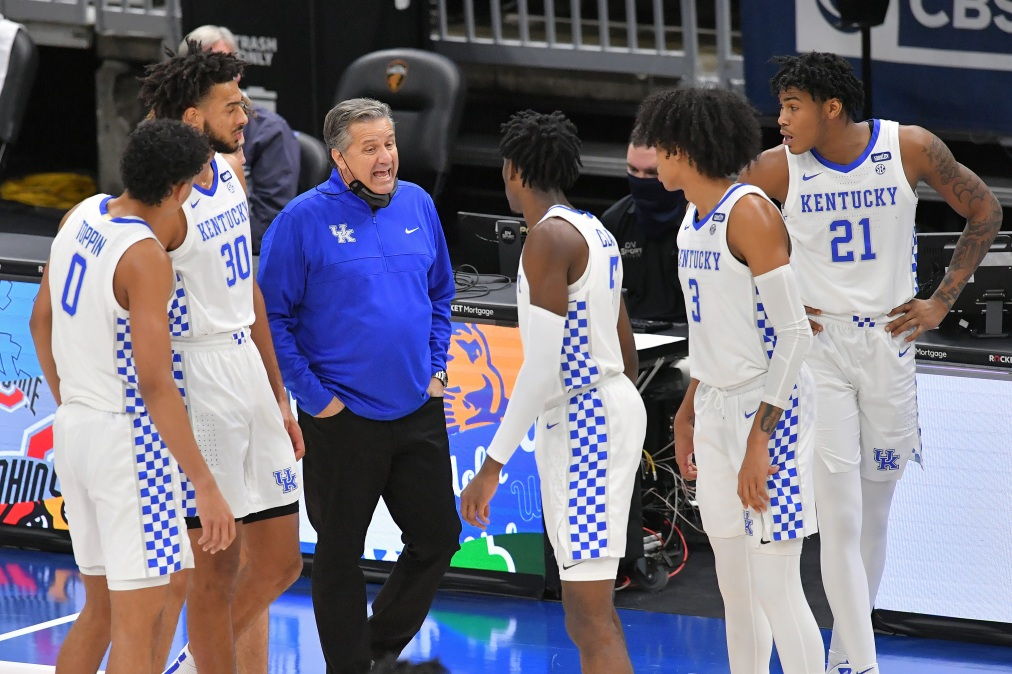 Head coach John Calipari of the Kentucky Wildcats talks to his players during a time-out during the second half against the North Carolina Tar Heels at Rocket Mortgage Fieldhouse on December 19, 2020 in Cleveland, Ohio. The Tar Heels defeated the Wildcats 75-63.