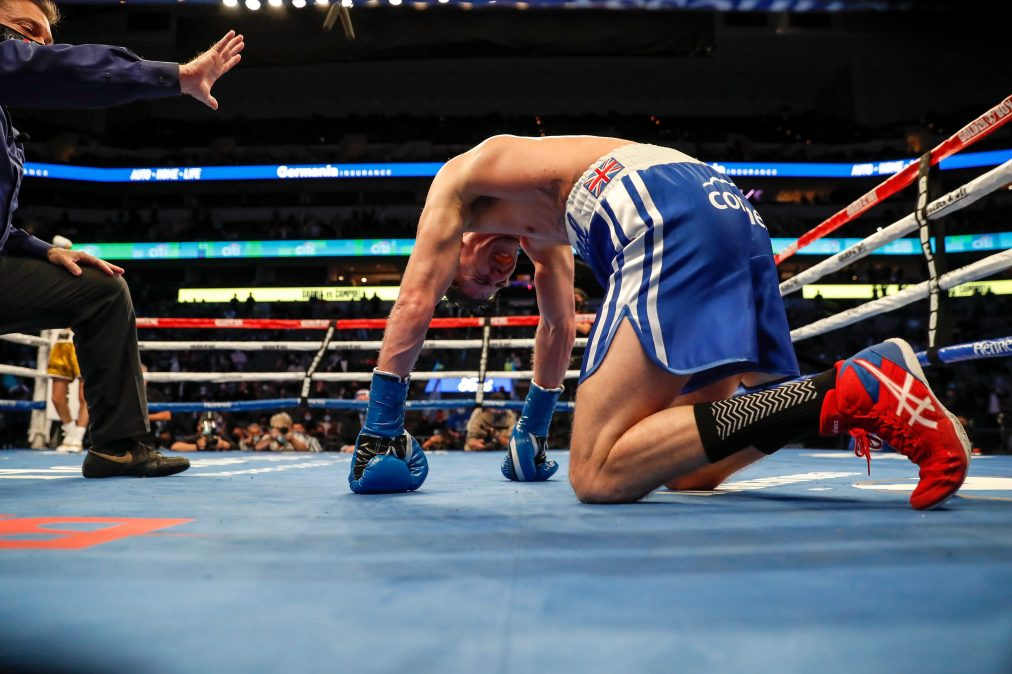 Luke Campbell kneels on the canvas after a body shot by Ryan Garcia