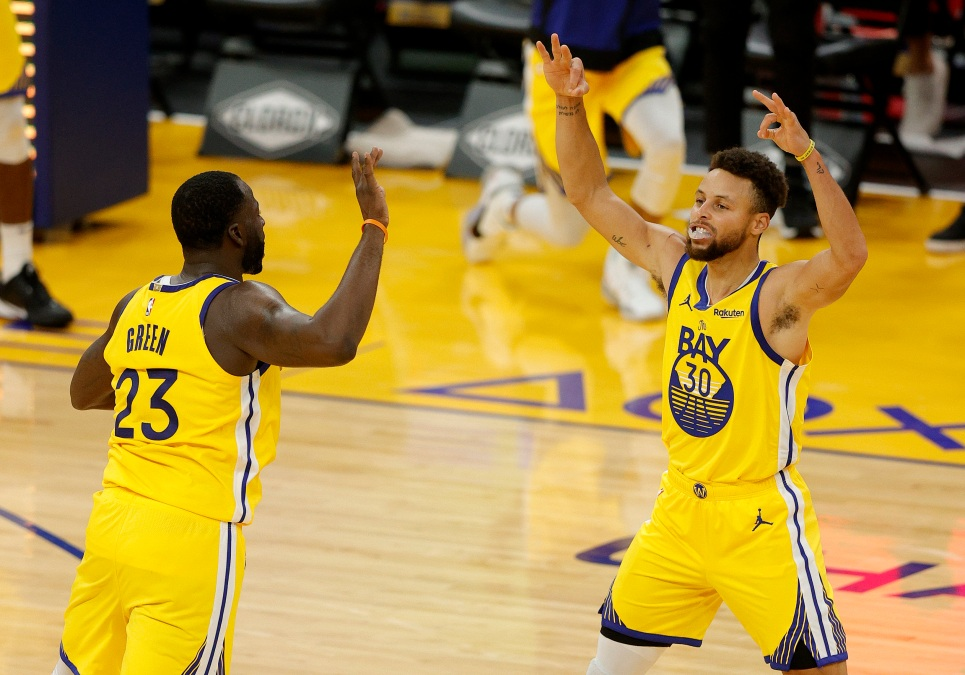 Steph Curry celebrates a make with Draymond Green.