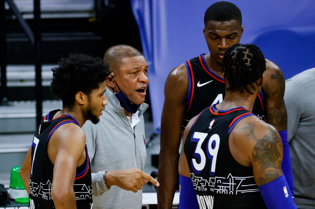 Head coach Doc Rivers speaks to players during the second quarter against the Denver Nuggets at Wells Fargo Center on January 09, 2021 in Philadelphia, Pennsylvania.
