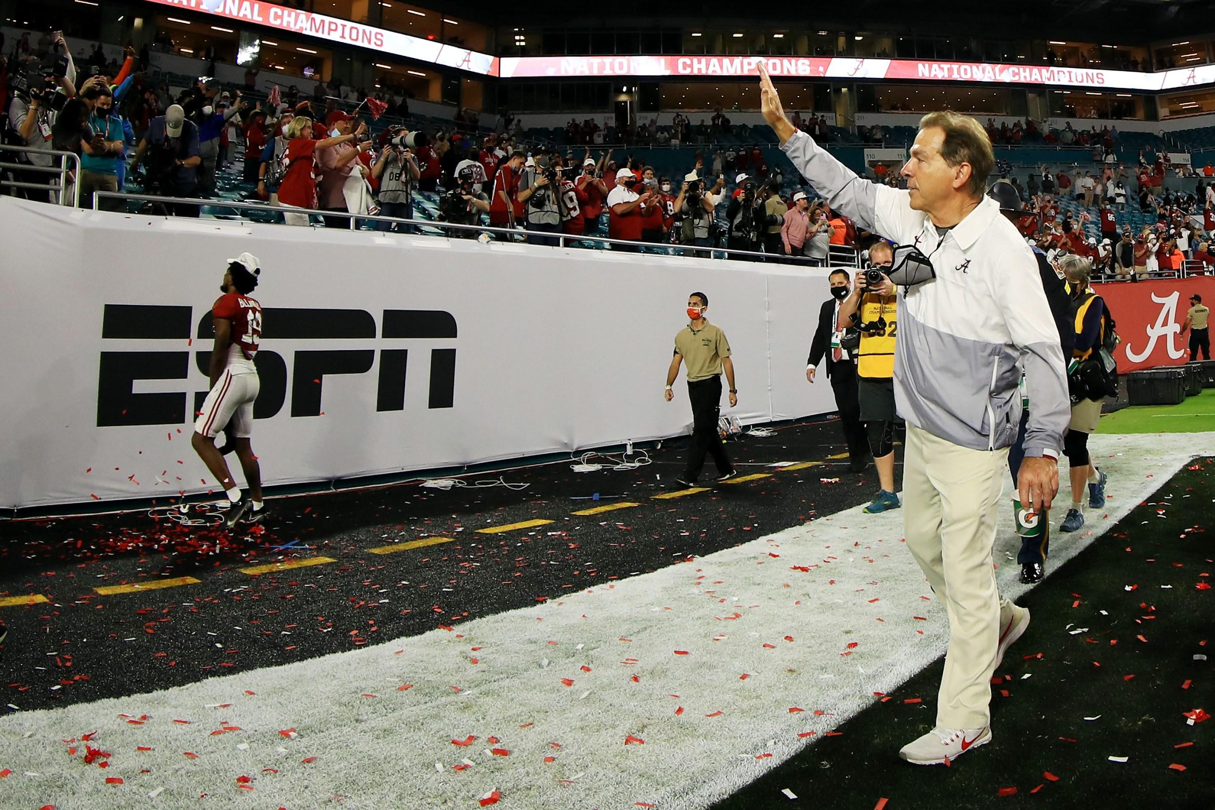 Head coach Nick Saban of the Alabama Crimson Tide gestures to fans