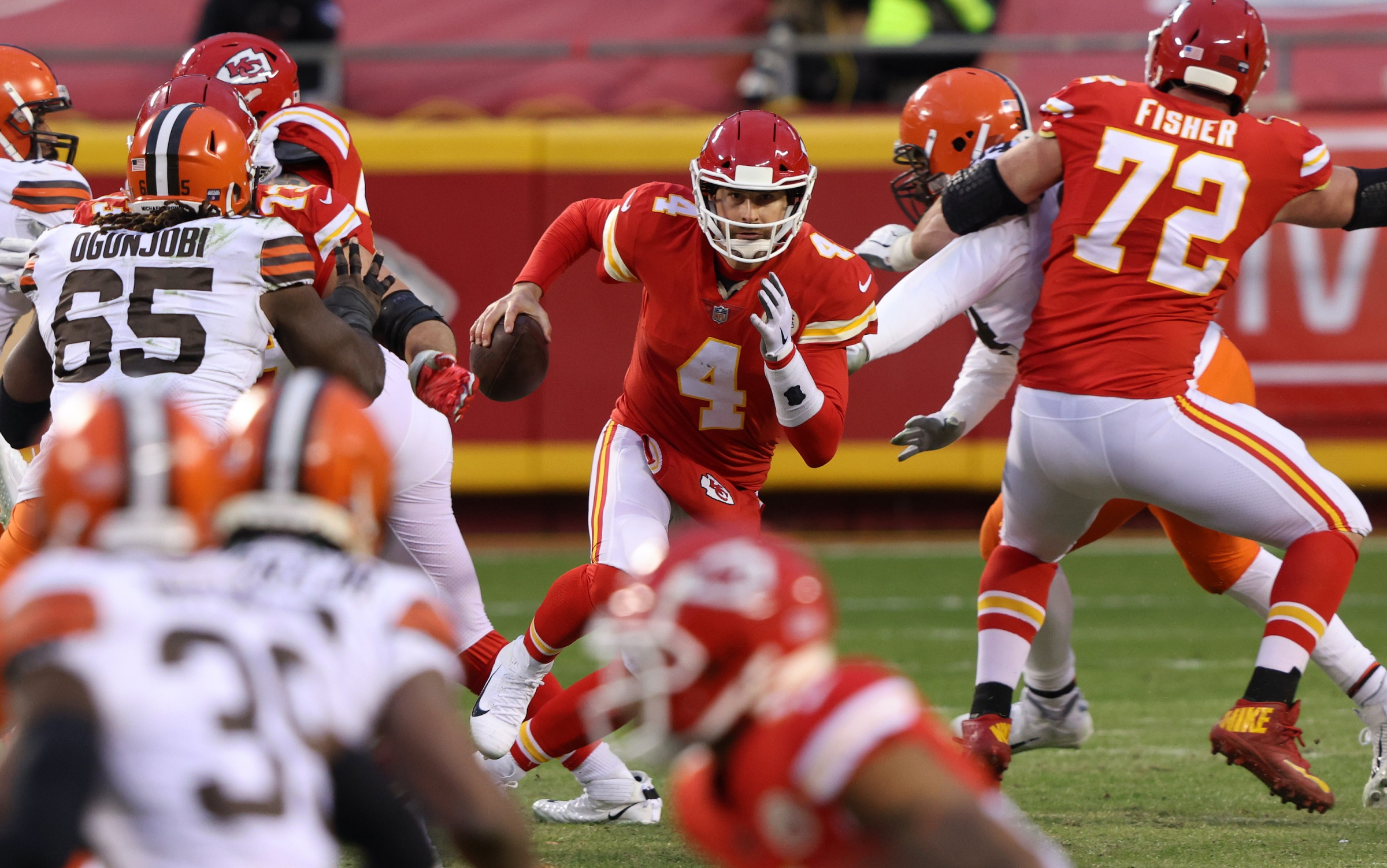 Quarterback Chad Henne #4 of the Kansas City Chiefs scrambles against the defense of the Cleveland Browns late in the fourth quarter of the AFC Divisional Playoff game at Arrowhead Stadium on January 17, 2021 in Kansas City, Missouri.