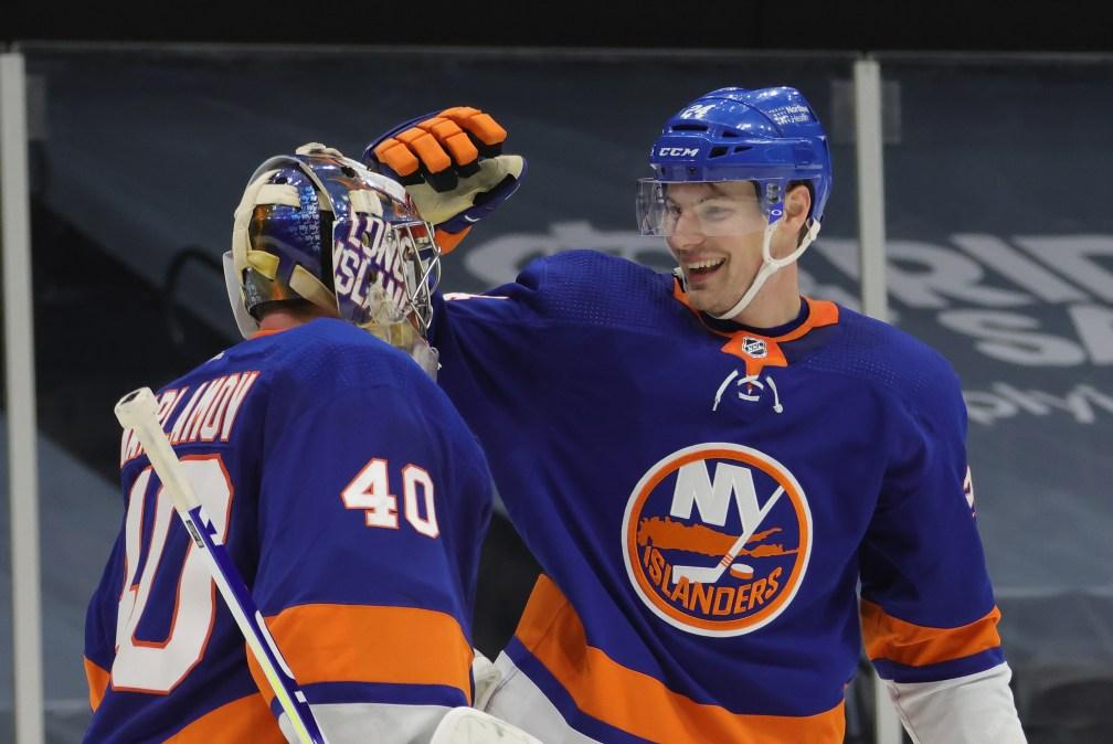 Semyon Varlamov #40 and Scott Mayfield #24 of the New York Islanders celebrate