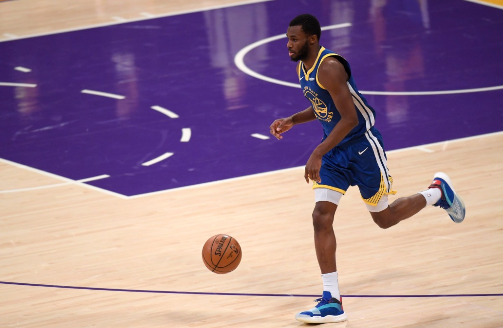 LOS ANGELES, CALIFORNIA - JANUARY 18: Andrew Wiggins #22 of the Golden State Warriors brings the ball up court during a 115-113 Warrior win over the Los Angeles Lakers on Martin Luther King Jr. Day at Staples Center on January 18, 2021 in Los Angeles, California. NOTE TO USER: User expressly acknowledges and agrees that, by downloading and/or using this Photograph, user is consenting to the terms and conditions of the Getty Images License Agreement. Mandatory Copyright Notice: Copyright 2021 NBAE (Photo by Harry How/Getty Images)