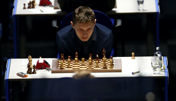 BEVERWIJK, NETHERLANDS - JANUARY 21: Andrey Evgenyevich Esipenko of Russia competes against Fabiano Caruana of the United States of America during the 83rd Tata Steel Chess Tournament held in Dorpshuis De Moriaan on January 21, 2021 in Wijk aan Zee, Netherlands (Photo by Dean Mouhtaropoulos/Getty Images)
