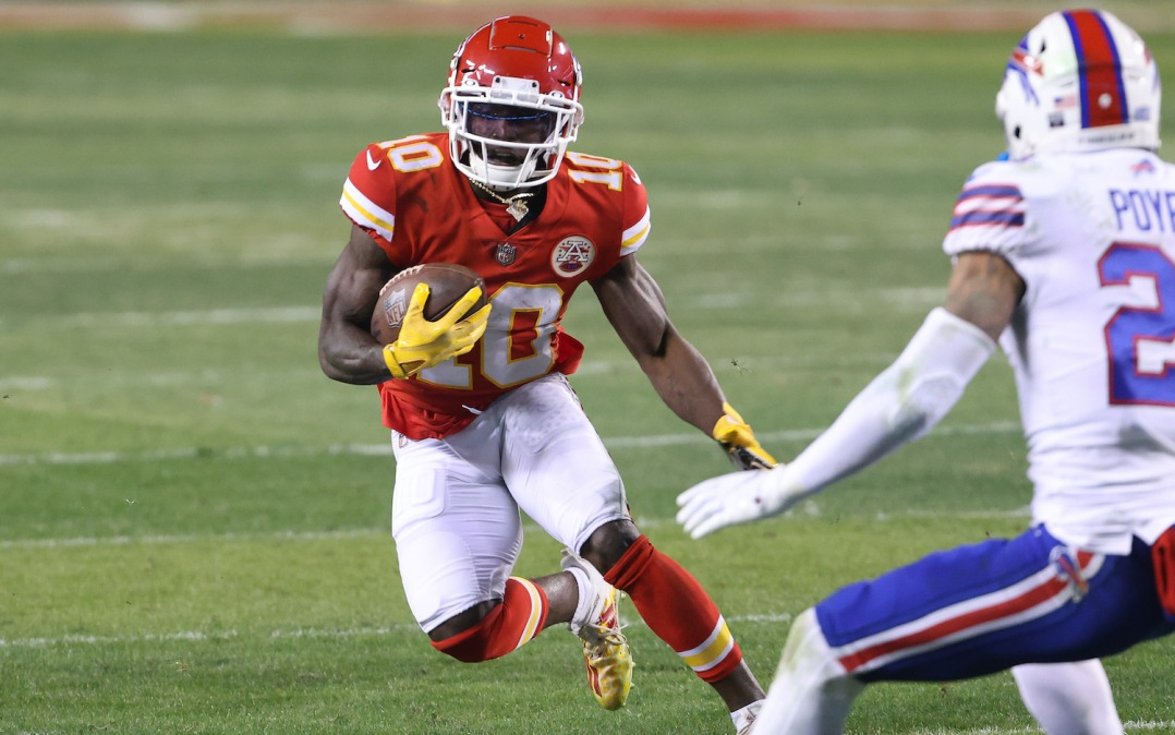 KANSAS CITY, MISSOURI - JANUARY 24: Tyreek Hill #10 of the Kansas City Chiefs runs with the ball in the second half against the Buffalo Bills during the AFC Championship game at Arrowhead Stadium on January 24, 2021 in Kansas City, Missouri. (Photo by Jamie Squire/Getty Images)