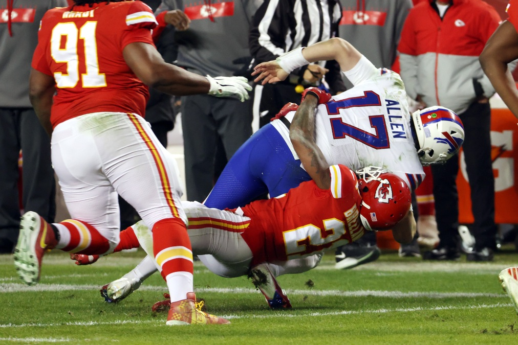 Josh Allen #17 of the Buffalo Bills is tackled by Bashaud Breeland #21 of the Kansas City Chiefs