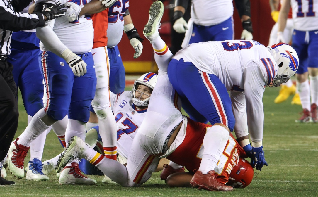 KANSAS CITY, MISSOURI - JANUARY 24: Dion Dawkins #73 of the Buffalo Bills hits Alex Okafor #57 of the Kansas City Chiefs after a play in the fourth quarter during the AFC Championship game at Arrowhead Stadium on January 24, 2021 in Kansas City, Missouri. (Photo by Jamie Squire/Getty Images)