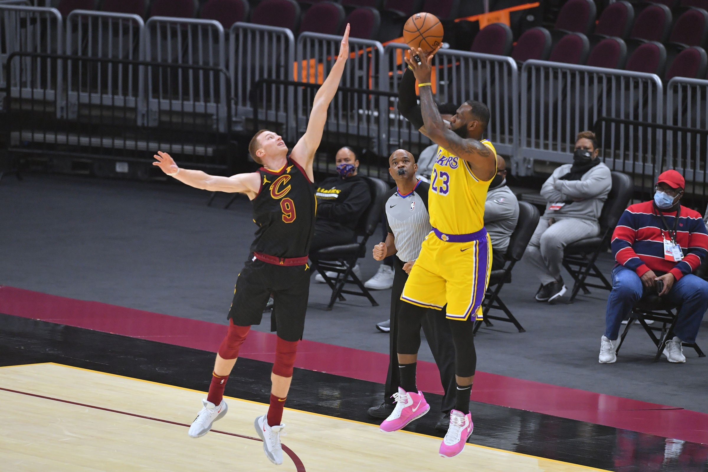 LeBron James shoots over a member of the Cleveland Cavaliers